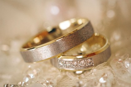 beautiful shiny wedding rings with diamonds close-up