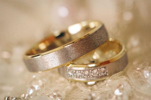 beautiful shiny wedding rings with diamonds close-up